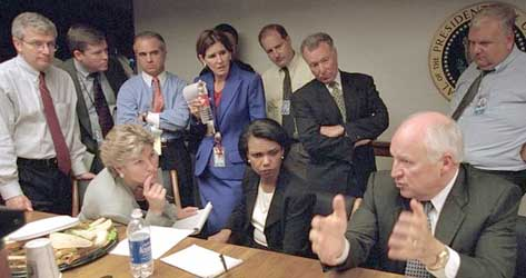 Dick Cheney in the PEOC, speaking to administration officials including (from left) Joshua Bolten, Karen Hughes, Mary Matalin (standing), Condoleezza Rice, and I. Lewis 'Scooter' Libby.
