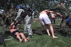 Military medical personnel tend to simulated victims during the exercise 'Cloudy Office.'