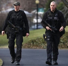 Secret Service emergency response team officers patrolling the South Lawn of the White House.