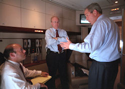 President Bush speaking with Karl Rove and Ari Fleischer on Air Force One on September 11.