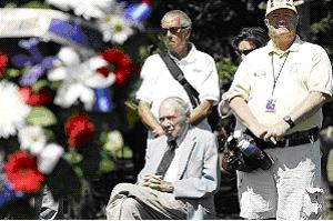 Stanley Karnow, seated, in Washington, paying respect to the first American causalities killed in Vietnam. July 8, 2009.