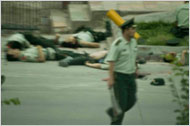 The Kashgar attack: a policeman holding a machete.