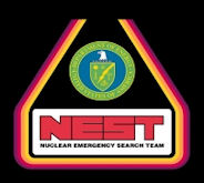 Logo of the Nuclear Emergency Search Team.