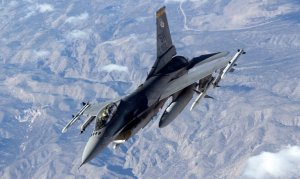 An F-16 heading to the combat ranges of Nellis Air Force Base, Nevada, for the Red Flag training exercise in January 2006.