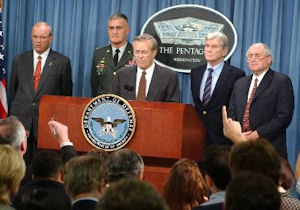 Donald Rumsfeld (center) with, left to right, Secretary of the Army Tom White, Chairman of the Joint Chiefs of Staff Henry Shelton, and Senators John Warner (R-VI) and Carl Levin (D-MI).