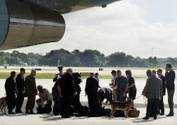 Secret Service agents inspecting the luggage of members of the media travel pool at Sarasota-Bradenton International Airport.