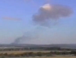 Smoke rising, minutes after Flight 93 crashes in Pennsylvania.