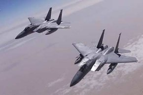 F-15s from the 1st Fighter Wing at Langley Air Force Base patrol the southern no-fly zone in support of Operation Southern Watch.