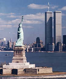 The Statue of Liberty, with the World Trade Center standing behind it.