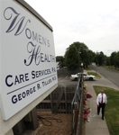 Flowers adorn the sidewalk outside George Tiller's clinic in Wichita, Kansas, laid in his memory.