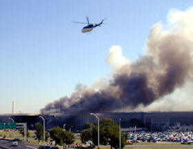 A US Park Police helicopter flying above the burning Pentagon.