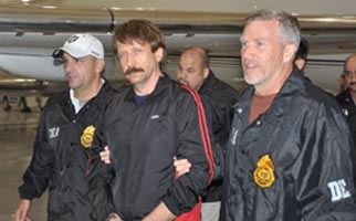 Victor Bout being escorted by Drug Enforcement Administration agents as he is extradited to the US.