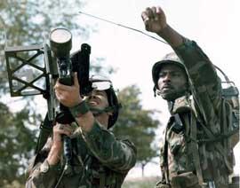 Soldier firing a Stinger missile.