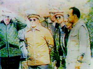 William Casey (left, with glasses) and General Akhtar Abdur Rahman (center) touring Afghan training camps in the 1980s.