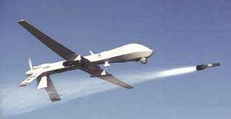 A Predator drone firing a Hellfire missile.