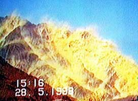 Pakistan's first nuclear  test take place underground but shakes the mountains above it.