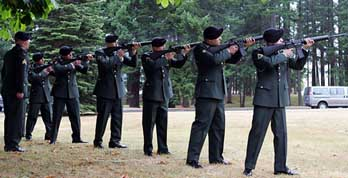 Soldiers salute their fallen comrades at a Fort Lewis memorial service.