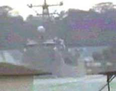 A still from the casing video shows a US warship docked in Singapore.