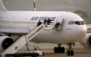 French special forces storming the hijacked Air France plane.