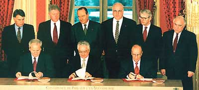 In the front row from right to left: Slobodan Milosevic, Franjo Tudjman,  and Alija Izetbegovic, sign the Dayton accords. In the back row stands, from right to left, Felipe Gonzalez, Bill Clinton, Jacques Chirac, Helmut Kohl, John Major and Viktor Tchernomyrdine.