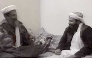 Khaled al-Harbi (right) talking to Osama bin Laden or one of his doubles.