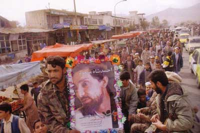 Northern Alliance forces entering Kabul. One holds a poster of recently assassinated Northern Alliance leader Ahmed Shah Massoud.
