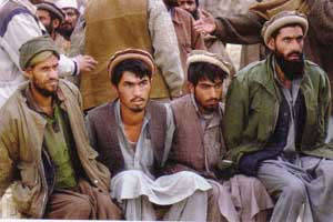 Four prisoners captured at Tora Bora and shown to the media on December 17, 2001.