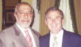 George W. Bush and with Muslim activist Abdurahman Alamoudi. Judging from the background, this picture was probably taken in a meeting held in 2000.