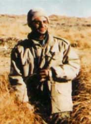 "The 2007 PBS documentary ""America at a Crossroads: The Brotherhood"" will claim that Spanish investigators discovered this picture of Darkazanli holding a Kalishnikov rifle in Afghanistan."