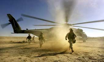 US Marines landing near Kandahar on December 10, 2001.