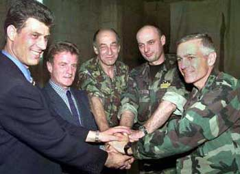 From left to right: Hashim Thaci, UCK leader; Bernard Kouchner, UN Administrator of Kosovo; Gen. Sir Michael Jackson, KFOR Commander; Agim Ceku, Commander of KLA; Gen. Wesley Clark, NATO Commander.