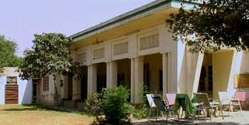 Bin Laden first works for Maktab al-Khidamat from this building in Peshawar, a former British government guesthouse.