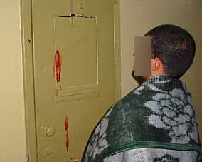 An Abu Ghraib detainee's head hitting a wall on a different occasion. This takes place on December 2, 2003.