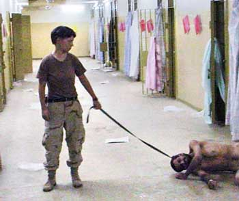 Lynndie England dragging a prisoner nicknamed Gus on October 24, 2003.