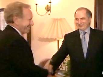 Chalabi shaking hands with Sen. Joe Lieberman, date unknown. While Lieberman is a Democrat, his hawkish foreign policy stance will eventually force him to leave the Democratic party and become an independent.