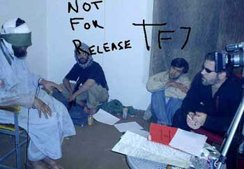 Jonathan Idema (far right) and his colleagues interrogating an Afghan.