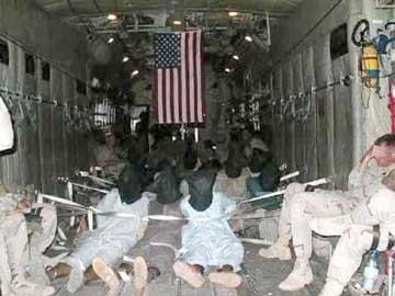 Prisoners being flown to Guantanamo.