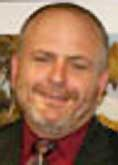 R. Scott Shumate.