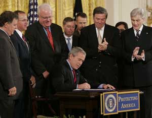 President Bush signs the Military Commissions Act into law.