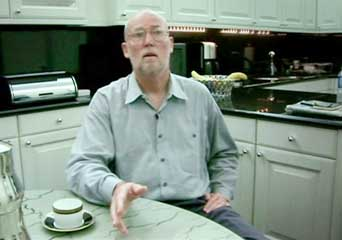 Matthew Edmonds sitting in the kitchen where he and his wife Sibel claim their encounter with the Dickersons took place.