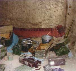 Radios, weapons, and simple supplies in a Tora Bora cave allegedly occupied by al-Qaeda forces. 