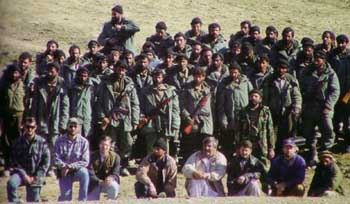 US Special Forces in the foreground with their Afghan allies in the rear. The allies are wearing US-issued parkas.