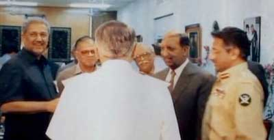 A. Q. Khan (left) and Pervez Musharraf (right).