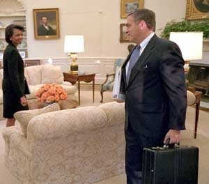 Condoleezza Rice and George Tenet in the White House. This picture is actually taken on October 8, 2001, and President Bush is elsewhere in the room.