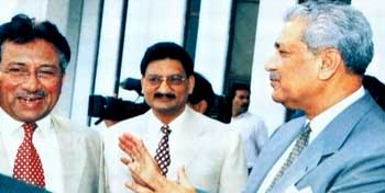 Pakistani President Pervez Musharraf (left) and A. Q. Khan (right).