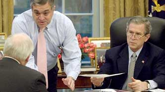 A White House meeting in March 2003. From left to right: Cheney, Tenet, and Bush.