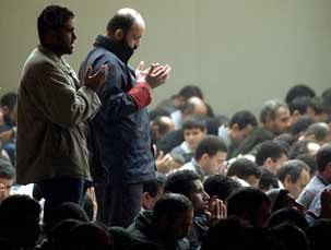 Friday prayers outside the Islamic Cultural Institute, on October 19, 2001. 