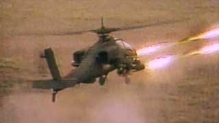 A Pakistani attack helicopter fires at Ahmed Said Khadr's safe house.
