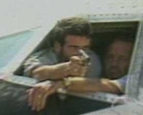 Imad Mugniyah, holding gun, in a 1985 TWA hijacking.