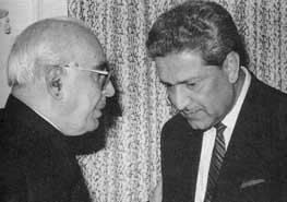 Pakistani finance minister Ghulam Ishaq Khan (left) and A. Q. Khan.